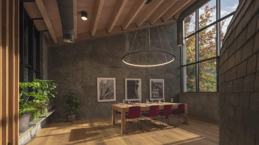Mesa y techo en Interiorismo Estratégico en comedor para clientes de CUPA Pizarras